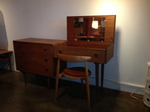 """Fabulous 1960's teak vanity with 3 drawers - spectacular condition, lovely patina - use as a vanity or re-purpose as a desk - the inside of the side with the mirror has lovely sold wood dividers - this lovely piece with it's many uses measures - 63.5""""L x 16.25""""D x 32""""H - (SOLD)"""