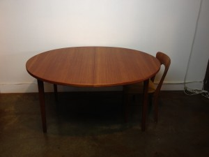 """Gorgeous Scandinavian Oval teak dining table - comes w/2 leaves -quality craftsmanship - note the unique middle leg that drops down when fully extended - newly re-finished - 58.5""""diameter each leaf is 19.75""""L fully extended - 98'L - (SOLD)"""