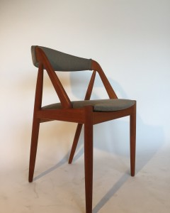 Super stylish teak dining chair - designed by Kai Kristiansen - great vintage condition - use as is or priced so you can re-do to suit your taste - one available - (SOLD)