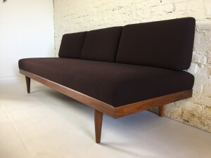 """Spectacular Mid-century Scandinavian Modern sofa with secondary sleeping function - with storage underneath for your sheets/blanket - model Svanette Designed by Ingmar Relling for Ekornes - Norway - circa early 1960's - newly refinished frame and new foam in seat and re-upholstered in a gorgeous high quality wool by Kvadrat in a rich dark chocolate brown - perfect for all spaces - brilliant design - measures - 75""""L x 29.5""""Dx 29.5""""H (SOLD)"""