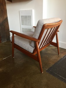 Handsome 1950's Danish teak easy chair - newly re-finished frame - new straps in the seat deck - Made in Denmark - very comfortable - sleek classic look - (SOLD)