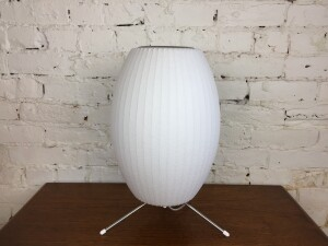 """Designed by George Nelson in 1952 for Herman Miller -this incredible Bubble Lamp adds a touch of softness and luminosity to interiors. it is comprised of sturdy, lightweight steel frame yet have a delicate, floating quality -stands17""""H - this one was produced in recent past - (SOLD)"""