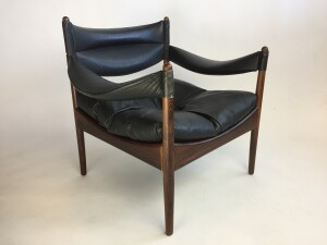 Gorgeous black leather and Rosewood armchair designed by Kristian Solmer Vedel, for Soren Willadsen - Made in Denmark circa 1963 - the leather is in very nice vintage condition and the rosewood frame has been newly refinished and looks incredible - a RARE find - check out our other postings of a matching chair and a matching side table $1,600