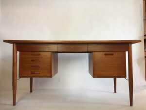 """Handsome 1960s executive teak desk designed by Gunnar Tibergaard - Made in Denmark - perfect combination of 3 drawers on the left a file cabinet on the right and a center drawer :) - this beauty is finished on all sides so could be used in the middle of a room - newly refinished-measures - 60.5""""L x 29.5""""D x 29.5""""H (SOLD)"""