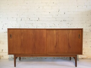 Exceptional Mid-century Modern teak sideboard designed by Arne Hovmand Olsen - Made in Denmark - incredible high quality cratsmanship - gorgeous patina -lovely finished back so would be perfect as a room divider - the inside left reveals 4 small dovetailed drawers and the right has one adjustable shelf - would make a fabulous media unit and/or a use it in your dining room - office... many uses - (SOLD)