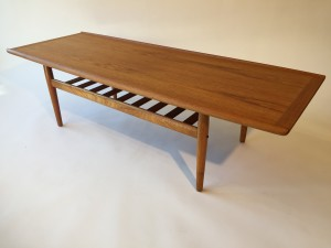"""1960's Danish Modern 2 tier teak coffee table designed by Grete Jalk for Glostrup - Made in Denmark - lovley re-finished condition - 63.5"""" L x 23.5"""" D x 17.5"""" H (SOLD)"""