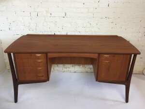 Exceptional Mid-century teak executive desk designed by Svend Aage Madsen for H.P. Hansen - stamped on underside -- finished on all sides - bar on the backside ( key included ) along with an adjustable shelf - front features 5 drawers - one being a file cabinet - all dovetailed drawers - lip at the back - stylish from all angles - perfect for anyone that wants a super functional well constructed desk that also looks incredible - newly refinished from top to bottom -