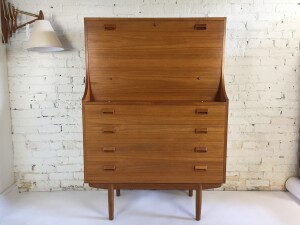A Gorgeous high quality detailed teak bureau by legendary designer Borge Mogensen. The fold-down front reveals a writing surface, two drawers and assorted storage slots. Manufactured by Soborg Mobelfabrik - Denmark - excellent vintage condition - $2200