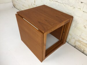 """Incredible Set of three interlocking nesting table that form an open side and bottom cube. Two tables slide into the sides of the center table. Designed by Kai Kristiansen for Vildbjerg Møbelfabrik - newly refinished - measures -17.75""""x 16"""" x 15.25""""H"""