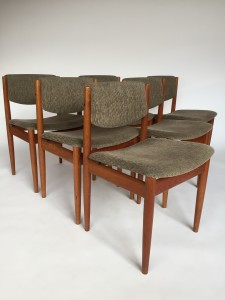 A Spectacular Set of 6 Danish Mid-century Modern dining chairs by Finn Juhl for France and Son - constructed of solid teak - the quality of these chairs is what is to be expected from the combo of this legendary designer and manufacturer. This design is very minimalistic and linear, the subtle details such as the floating seat supported by metal posts. and a slightly curved backrest for support - recently re-upholstered - (SOLD)