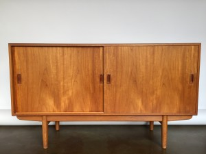 """1950's teak sideboard by Borge Mogensen for Soborg Mobelfabrik - exquisite quality craftsmanship - in the inside right side you will find 4 exceptionally made solid dovetailed beech drawers , that can be adjusted, the other side has a couple of shelves that can also be adjusted - this amazing piece of furniture also boasts dovetails under the bottom - wood runners … I could go on... but you get the picture... nice size too - 59