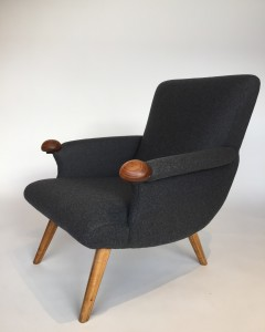 """This chair was designed in Vancouver in the Mid 60's by the upholsterer Helmut Krutz - between 1962 - 1977 Krutz produced and promoted his stylish """"contoured high back armchairs made to measure"""" in a organic style reminiscnet of Hans. J. Wegner and other Scandinavian designers - this beauty has been completely restored with all new latex and other quaity foam , strapping and covered in a gorgeous charcoal grey wool - OMG don't you just LOVE the teak ball arm rests :) - $1800 (SOLD)"""