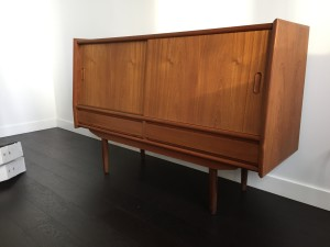 """Check out this little cutie - Danish Modern teak sideboard with a unique shape and a fantastic smaller space, but has loads of storage behind those 2 sliders and 2 drawers below - fantastic vintage condition - call for measurements Wednesday - 48.75""""L x 14.5""""D x 32.5""""H (SOLD)"""