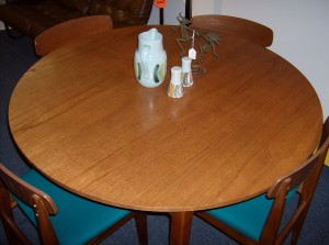 Fantastic Mid-century modern teak round dining table w/built in butterfly leaf - (SOLD)