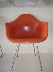Stunning original 1950's Eames fiberglass arm chair on an original X base/with original glides - the color is coral -it is in beautiful condition - these iconic Mid-century modern chairs look fantastic in any home and or office!! - (SOLD)