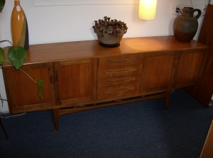 """Beautiful Mid-century modern 2 tone teak sideboard with lovely cupboards on either end, plus 4 beautifully dovetailed drawers in the center- lots of storage  - this piece also boasts a base that has the illusion of floating - NICE!! - Measurements: 7ft long X18""""deep X31.25""""high - (SOLD)"""