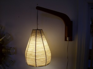 """1960's teak wall light with rafia shade - the arm can be swung from one side of the wall to the other - great for positioning wherever you need it to be - it measures 12"""" from the wall to the end of the teak arm - (SOLD)"""