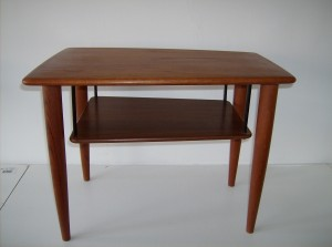 """Incredible Mid-century modern teak 2 tier end table - stunning design - the shelf appears as if it were floating - great vintage condition - Measurements - 26"""" length X 19"""" height X 18"""" width that taper to 15"""" -  SOLD (0 available)"""