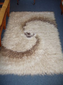 Beautiful vintage original Flokati from Greece(still has the tags) - the swirl of brown is really cool - fantastic condition - measures 5'X7' - (SOLD)
