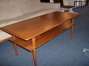 """1960's 2 tier teak coffee table - fantastic design/ super quality and super functional - the condition is good - the top could probably use a little steel wool and some teak oil, but definately not necessary - this piece measures - 4ft long X 19.5"""" wide by 17.5"""" tall - (SOLD)"""