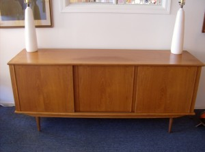 """Handsome Mid-century modern teak sideboard - 3 sliding doors with loads of storage/ a couple drawers inside and shelves - this piece measures - 71"""" X 19"""" X 30""""H - (SOLD)"""