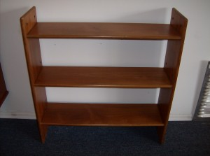 """This small Danish teak bookshelf is great on it's own, or can be added to other like pieces as part of a modular teak shelving unit - this piece measures - 31.5""""L X 33""""H X 9"""" D - (SOLD)"""