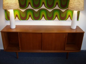 """Fantastic 1950's quality Danish teak sideboard - manufactured by Dyrlund - this peice has a beautiful dark rich patina and would look great in any Mid-century modern home and/or office, however there is one small flaw, it's not a huge deal for some folk,  but definately worth mentioning - this peice would have originally had 2 doors where it is open now... but we think it is fabulous as it is, but you be the judge - this peice measures 71.5 L X29.5""""H X 16.5"""" D - (SOLD)"""