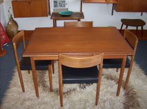 Wonderful Danish teak dining table and 4 chair set - the table extends on either end to accomodate more family and friends - the black naughahyde chair seats are in good condition no rips or tears... the table is in good overall condition with minor flaws - sold as a set - SOLD