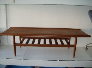 """Marvelous Danish teak 2 tier coffee table designed by Grete Jalk - the top could probably use a once over, as the finish is a little uneven, but overall what a beautiful piece - this piece measures  59""""L X 22""""D X 17""""H - (SOLD)"""
