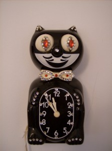 Funky 1950's Kitty Kat Klock - the jewelled version - keeps good time - the tail is missing - as is - (SOLD)