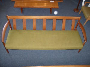 A spectacular teak 3 seater sofa by one of Denmark's most remarkable designer's -- Grete Jalk - the design is absolutely stunning - the green upholstery is in really nice condition - the teak frame has a couple small repairs (nothing structural) overall really nice condition - (SOLD)