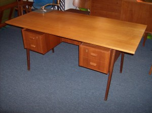 A Fantastic Mid-century modern Danish teak desk - 4 drawers and a bookshelf on the other side - the top is a replacement top - overall really nice condition - just over 5 feet in length - (SOLD)